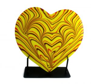 Fused glass heart sculpture with yellow dominant and red & orange accents