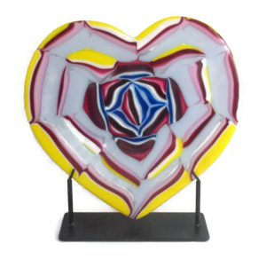 Heart sculpture with abstract rose in center