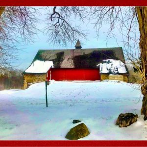 red barn with snowfall